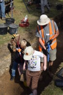 Two boys digging on an archaeological dig